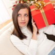 Young woman holding Christmas present — Stock Photo