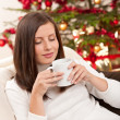 Brown hair woman relaxing with coffee on Christmas — Stock Photo
