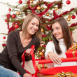 Two women packing Christmas present — Stock Photo