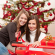 Two women packing Christmas present — Foto Stock