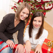 Two woman packing Christmas present — Stock Photo #4695782