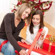 Two woman packing Christmas present — Stock Photo