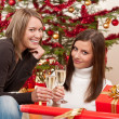 Two young woman with champagne and Christmas tree — Stock Photo #4695791
