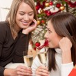 Two young women toasting with Champagne — Stock Photo #4695809