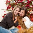 Two cheerful women with Christmas chains and balls — Stock Photo #4695833
