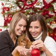 Two cheerful women with Christmas chains and balls — Stock Photo