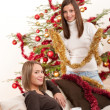 Royalty-Free Stock Photo: Two cheerful women with Christmas chains and balls