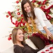 Two cheerful women with Christmas chains and balls — Stock Photo #4695842