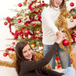 Two smiling women with Christmas decoration — Stock Photo #4695851
