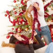 Two young woman having fun with Christmas decoration — Stock Photo