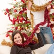 Two young woman having fun with Christmas decoration — Stock Photo #4695856