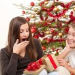 Two women unpacking Christmas present — Stock Photo