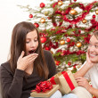 Two women unpacking Christmas present — Stock Photo #4695865