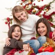 Three young women having fun on Christmas — Stock Photo #4695898