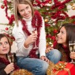 Three young women having fun on Christmas — Stok fotoğraf
