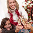 Three cheerful women having fun on Christmas — Stockfoto