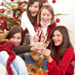 Four young woman on Christmas with champagne — Stock Photo