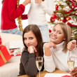 Four smiling women with glass of champagne on Christmas — Stock Photo
