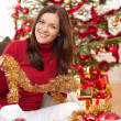 Attractive young woman with Christmas decoration — Stock Photo