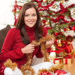 Attractive young woman with Christmas decoration — Stock Photo #4695975