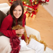 Attractive young woman with Christmas decoration — Stock Photo #4695978
