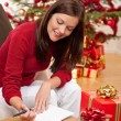 Attractive brunette writing Christmas cards — Stock Photo #4695983