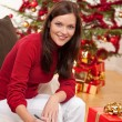 Attractive brunette writing Christmas cards — Stock Photo