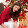 Attractive brunette writing Christmas cards — Stock Photo #4695988