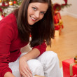 Attractive brunette writing Christmas cards - Stock Photo