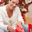 Young woman packing Christmas present — Stock Photo #4696006