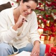 Attractive brunette writing Christmas cards — Stock Photo #4696013