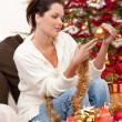 Attractive young woman with Christmas decoration — Stock Photo #4696019