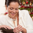 Attractive brown hair woman in front of Christmas tree — Stock Photo #4696023