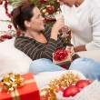 Young couple with champagne in front of Christmas tree — Stock Photo #4696036