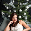 Provocative sexy woman posing in front of Christmas tree — Stock Photo #4696038