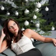 Provocative sexy womposing in front of Christmas tree — Foto de stock #4696039