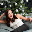 Provocative sexy woman posing in front of Christmas tree — Stock Photo #4696040