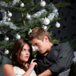 Royalty-Free Stock Photo: Extravagant man and woman in front of Christmas tree
