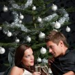 Young extravagant man and woman with champagne on Christmas — Stockfoto