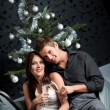Young extravagant man and woman with champagne on Christmas — Foto de Stock