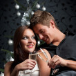 Young extravagant man and woman with champagne on Christmas — Stock Photo #4696065