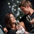 Young extravagant man and woman with champagne on Christmas — Stock Photo #4696067