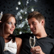 Young extravagant man and woman with champagne on Christmas - Stock Photo