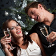 Young extravagant man and woman with champagne on Christmas — Stock Photo #4696069