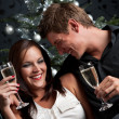 Young extravagant man and woman with champagne on Christmas — Foto Stock