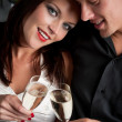 Portrait of extravagant man and woman with champagne - Stock Photo