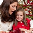 Mother with child opening present — Stock Photo