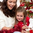 Stock Photo: Mother with child opening present