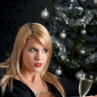 Blond woman with glass of champagne on Christmas — Stock Photo