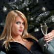 Portrait of blond sexy woman with glass of champagne — Stock Photo